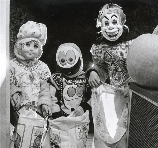 "#mondaymemories ""Pac-Man a model costume for gobbling treats in '83""  Halloween falls on a Wednesday this year, which means many communities will actually see real, live trick-or-treaters on October 31 itself.  On Halloween night in 1983, a Monday, Blade photographer Lloyd Ransom captured these young treaters starting their night's work on Barrington Drive. From left, Tiffany Kontak, 4, dressed as Strawberry Shortcake, Nathan Kontak, 2, as Pac-Man, and Kelly Kartori, 9, as a clown, were among thousands of youngsters who took to the streets looking for sugary results of the Halloween tradition.  Clowns and Strawberry Shortcake notwithstanding, Nathan's costume would have been the most culturally contemporary, as the arcade classic had hit America's shores from Japan — where it originally was Puck Man — just three years earlier in October 1980.  Surprisingly, our archives yielded no pictures of costume-goers as Inky, Blinky, Pinky, and Clyde, the four ghosts who chase our eager yellow hero through 256 levels of dot-munching video game innocence. The Blade had written separately that the appeal of the nonviolent game to Americans was immediate and was the first to cross genders in a significant way.  Candy, either digital or physical, can do that.  #toledoblade #theblade #toledoohio #youwilldobetterintoledo #itmatterswhereyoumakeit #glasscity #history #nostalgia #toledo #pacman #retrogaming #videogames #halloween"