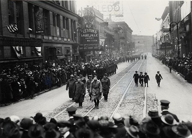 #mondaymemories Troops of the 37th Division march on St. Clair St. from Adams St. towards Madison St. on April 10, 1919, as four youngsters couldn't help but join. #veteransday #toledo
