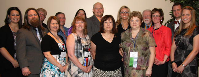 Front row (L to R):    Laycie Graves  - Student Intern;  Jason Young  - Senior Affiliate Delegate;  Glenda Haddock  - Secretary;  Donita Shipman  - Executive Treasurer;  Joan Hedrick  - Past President;  Kristi Littleton  - President Elect;  Tammy Homan  - President;  Amanda Rogers  - Student Scholarship.   Back row (L to R):    Chuck Eaves  - 6th District Rep;  Debra Hurst  - 3rd District Rep;  Dean Brake  - Senior Affiliate Delegate;  Norman Hente  - 4th District Rep;  Kelley McDonald  - Vice President;  Darrell McKay  - Parliamentarian;  Eric Rogers  - 5th District Rep.