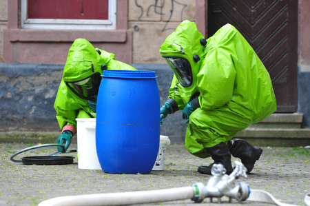 Chemists exploring barrel after spill at school Image Copyright :  Rainer Klotz