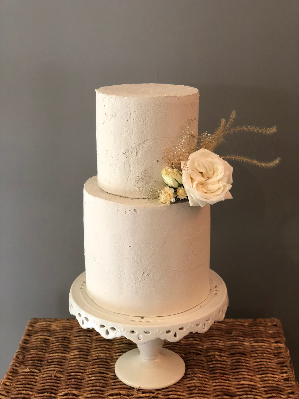 Cement Textured cake with fresh and dried flowers