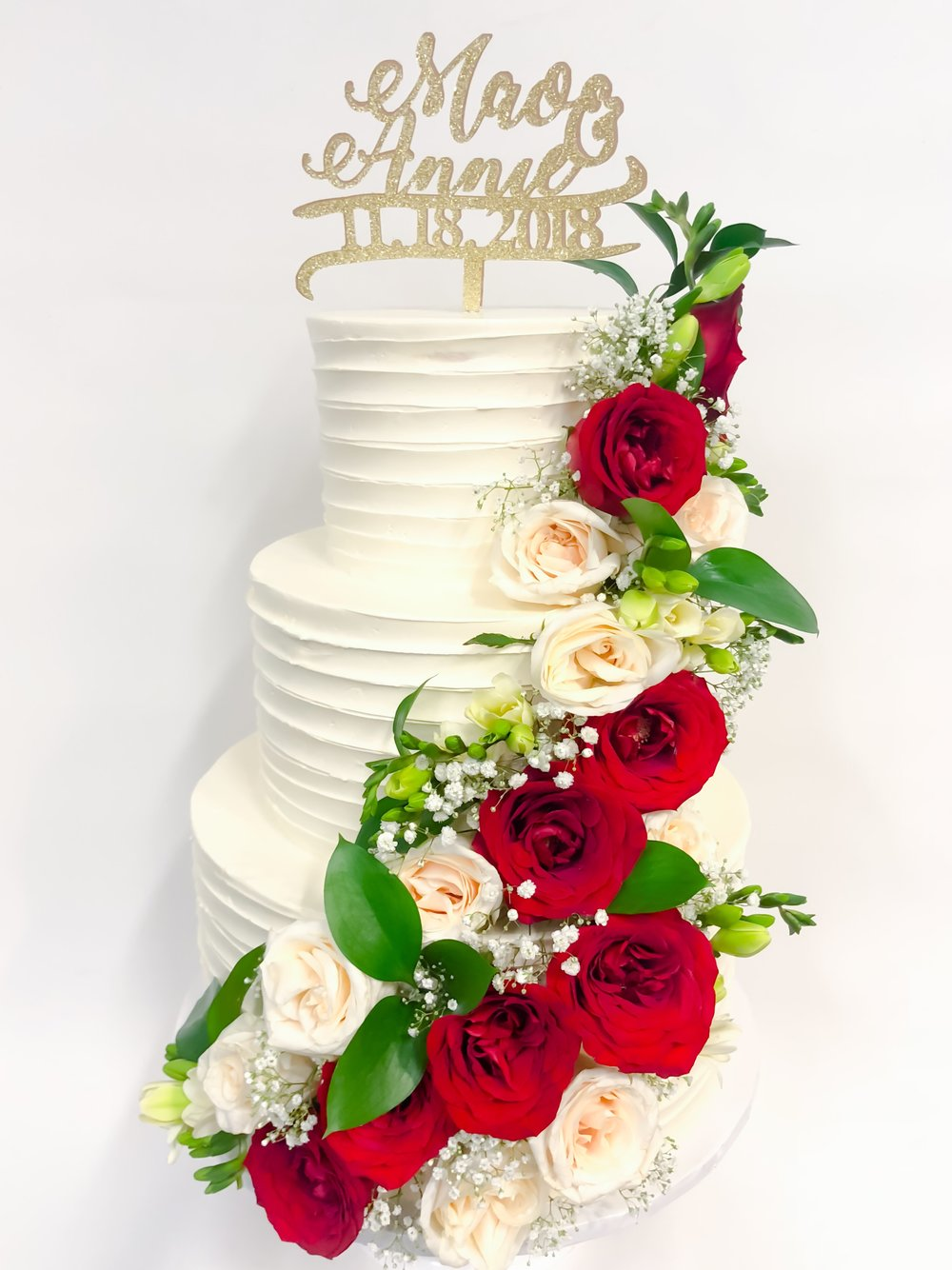 traditional horizontal buttercream cake with fresh roses