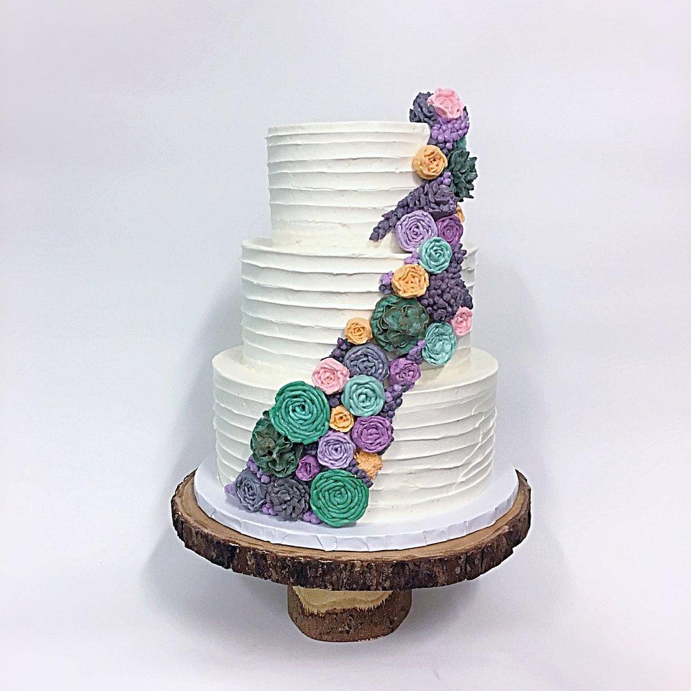 modern horizontal textured cake buttercream succulents