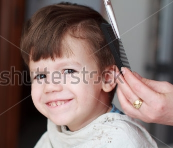 stock-photo-haircut-for-little-boy-professional-barber-teeth-smile-137647352.jpg