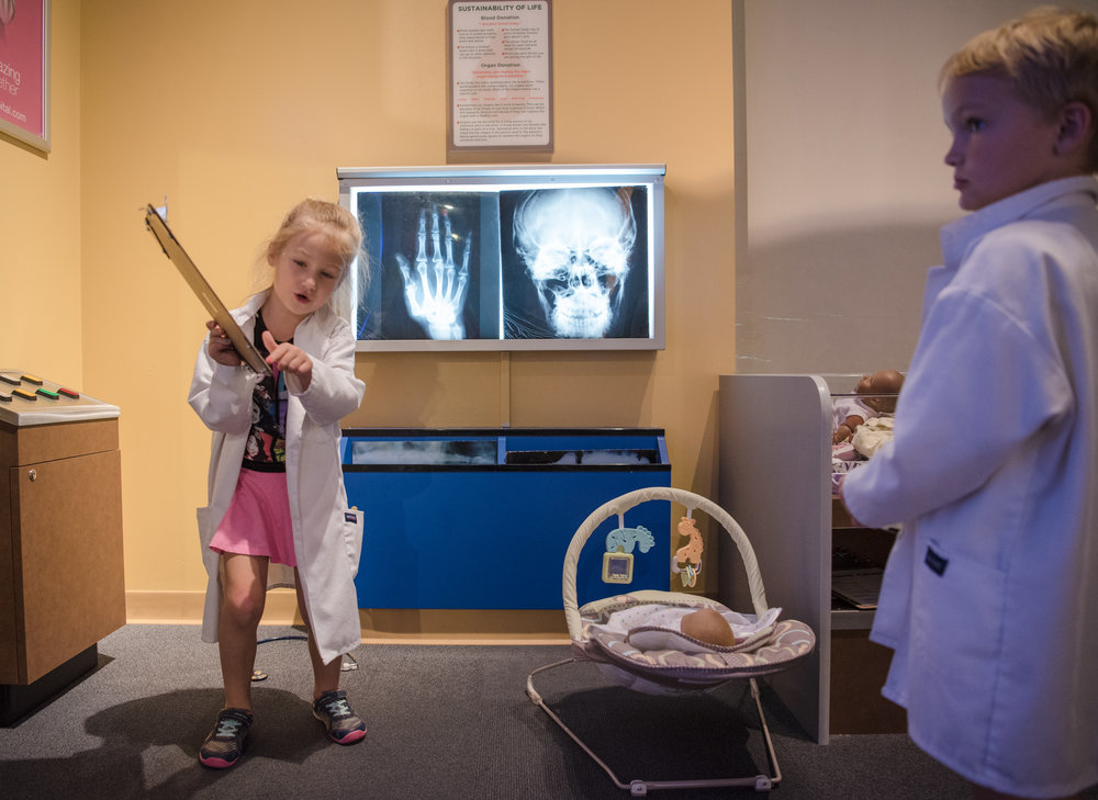 Keira O'Brien, 6, shows Mykolas Brown, 5, the protocol for the doctor's office at the Discovery Children's Museum on Friday, June 9, 2017, in Las Vegas. Morgan Lieberman Las Vegas Review-Journal