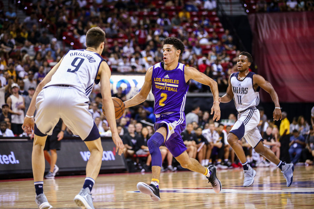 Los Angeles Lakers guard Lonzo Ball goes up against Dallas Mavericks guard Nicolas Brussino during the NBA Summer League semifinal game at Thomas and Mack Center on Sunday, July 16, 2017, in Las Vegas.