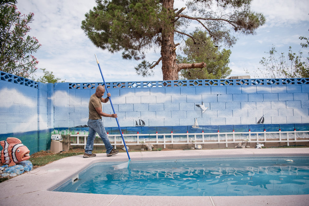 Ricardo Medrano cleans the pool in front of the mural he painted for his late children on Thursday, August 3, 2017, in Las Vegas. Morgan Lieberman Las Vegas Review-Journal