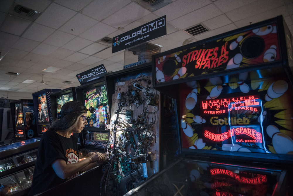 "Full-time volunteer Beth Kane cleans a ""Dr. Who"" pinball machine from the 80's at Pinball Hall of Fame on Tuesday, Aug. 22, 2017, in Las Vegas. Morgan Lieberman Las Vegas Review-Journal"