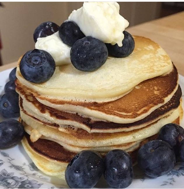 A simple stack of pancakes with a surprise: Lemon ricotta pancakes with a dollop of lemon cream cheese and Jersey fresh blueberries.