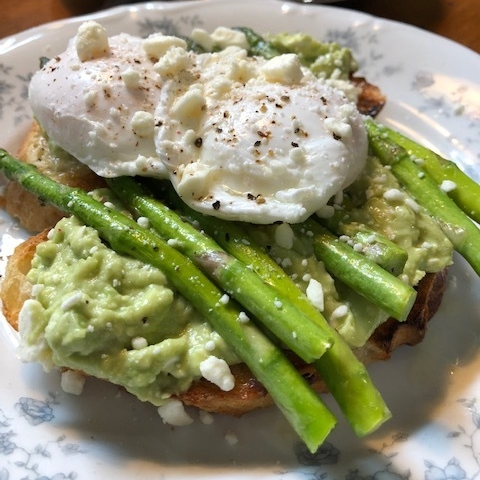 Glencairn Avocado Toast: Mashed avocados with fresh lemon juice and softened cream cheese, paired with sautéed Spring asparagus and a perfectly poached egg served over toasted artisan bread.