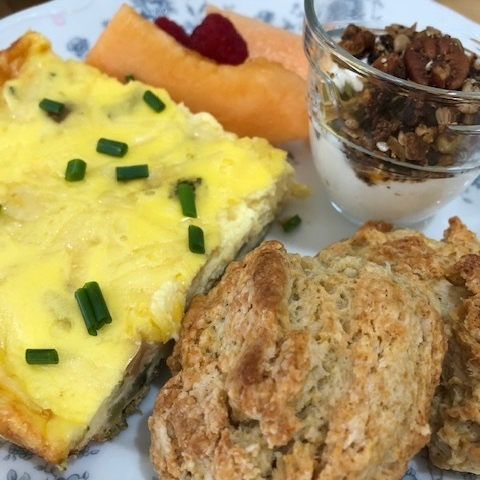 Quiche with homebaked scones and jam