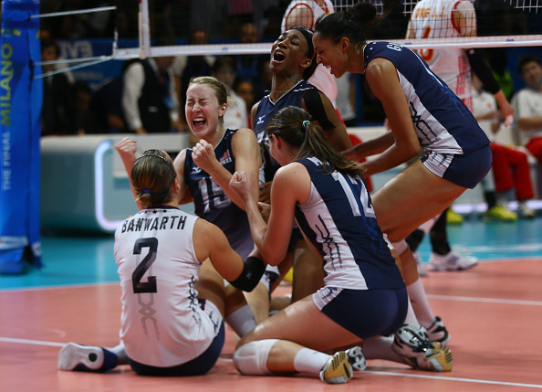 Kim and her teammates celebrate match point in Milan, Italy.