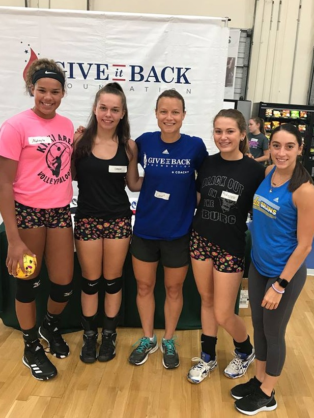 Courtney Thompson checks in with our group at last year's camp.