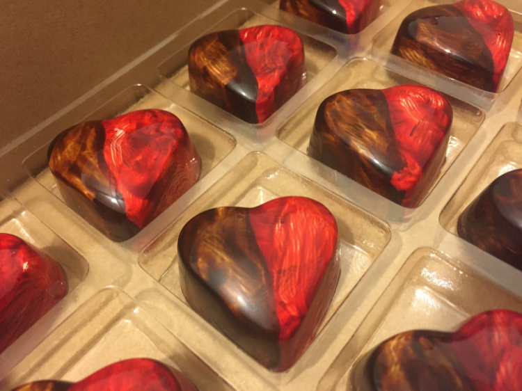 Our Dark Chocolate Peanut Butter and Jelly heart shaped bonbons in honor of Valentine's Day! Notice the unique design and appearance and yes, even the imperfections that we love so much!