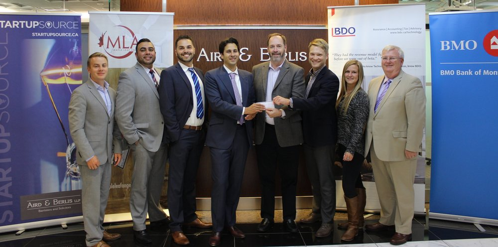 Representatives from Maple Leaf Angels Capital Corporation and Sponsors stand with the first limited partner of MLA48 Fund II