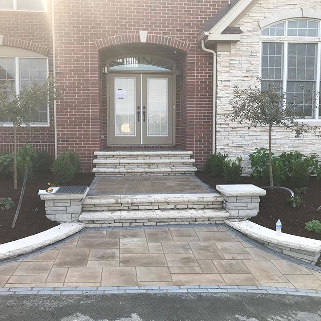 We are excited for this new landscaping and entryway that we designed to be completed! Things are looking great! We love transforming the residential landscape! #escapeslandscapedesign #unilock #bluehillsinc #welcomehome #barringtonil