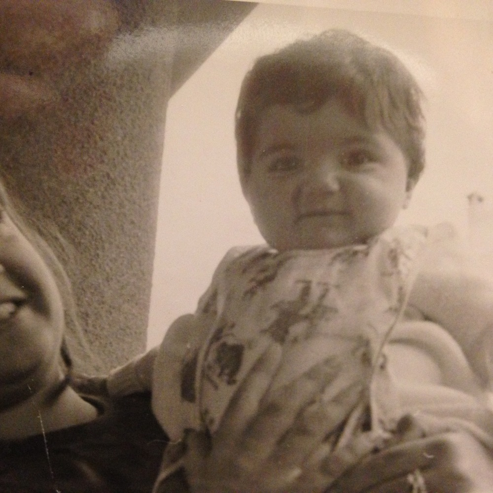 Me at 5 months old, in my mom's hands.