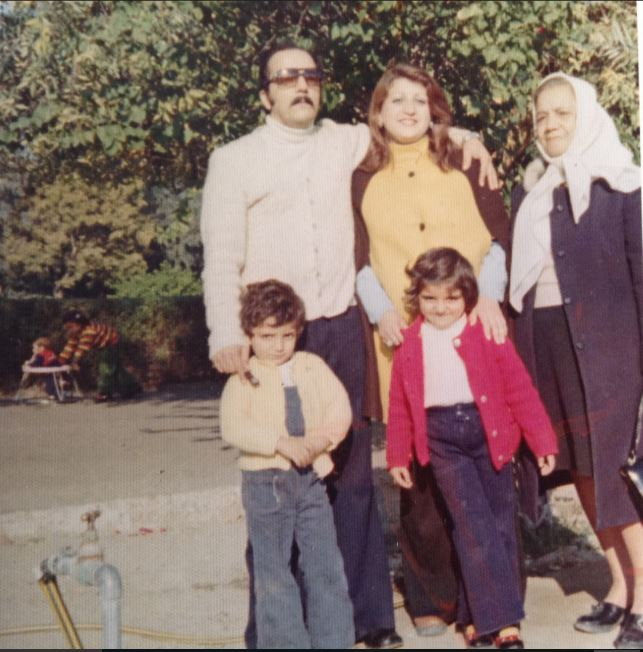 Age 5 with my mom, dad, brother and grandmother.