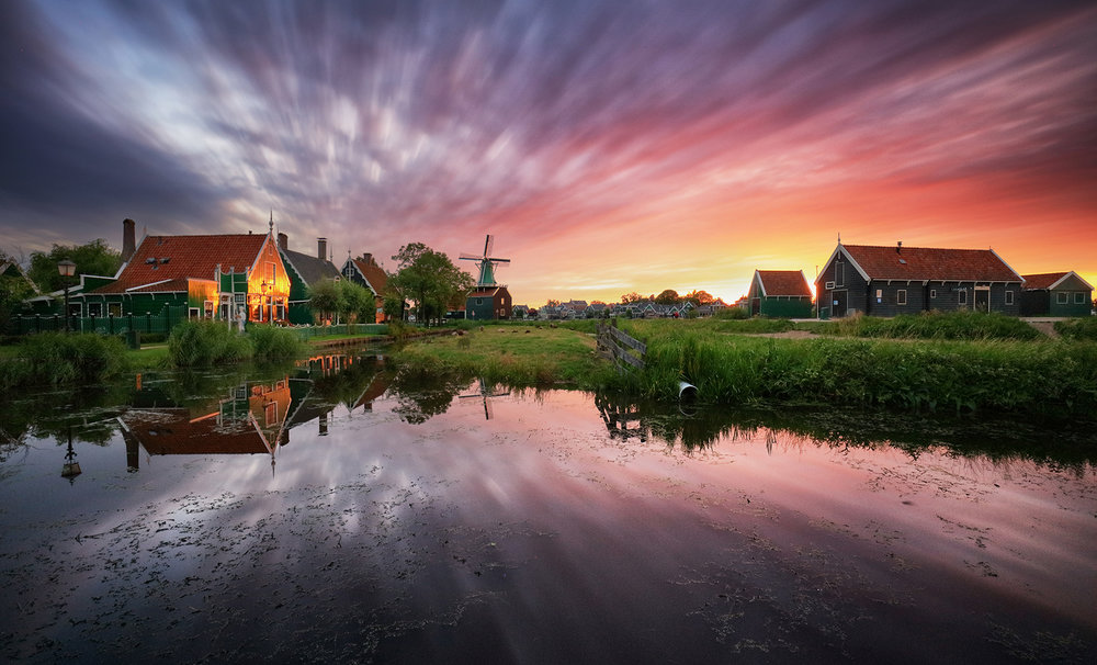 Traditional dutch windmill near the canal. Netherlands, Landcape