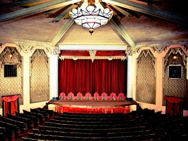 Interior shot of the Criterion Theatre prior to the full restoration; notice the keystone design element at the top of the Proscenium Arch.