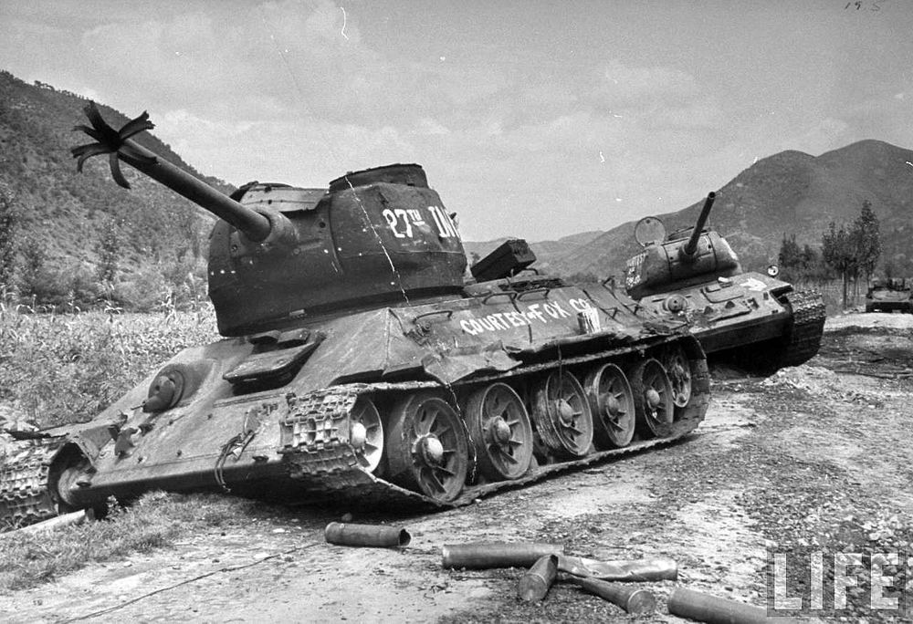 A pair of T-34/85s knocked out after the Battle of Osan. Arguably the greatest tank design of World War II, the T-34/85 was simple, had sloping armor providing adequate protection, and a 85mm main gun effective against other tanks. Source: Life Magazine.
