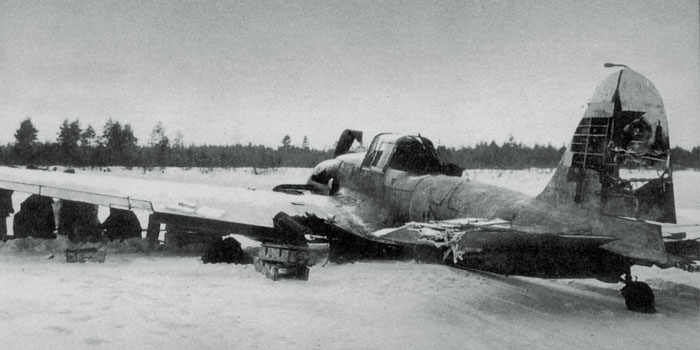 This Il-2M3 has made a wheels-up landing following severe flak damage to the vertical stabilizer. Note the crude whitewash pattern applied over the aircraft's camoflauge. Whitewash was generally applied in the field with whatever materials were on hand- it frequently wore off after a few weeks.