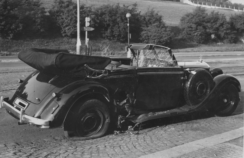 THE REMNANTS OF HEYDRICH'S CAR FOLLOWING THE ASSASSINATION. THE DAMAGE CAUSED BY THE GRENADE BLAST IS EVIDENT- PIECES OF THE CAR AS WELL AS GRENADE SHRAPNEL WERE PROPELLED INTO THE INTERIOR AND INTO HEYDRICH.