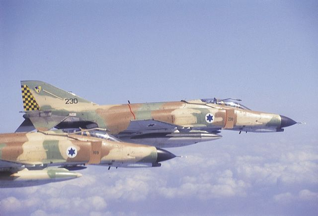 Two Israeli F-4 Phantoms fly in formation.