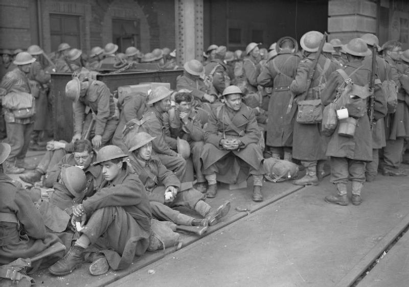 British soldiers, just having arrived at Dover exhausted from their ordeal in France, await a train to take them north. Photo source: Wikipedia.