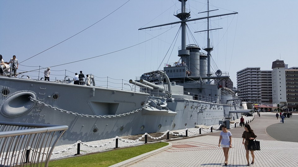 VIEW OF THE BOW OF THE MIKASA, AS IT APPEARS TODAY. THIS VIEW CLEARLY SHOWS THE SHIP'S CURRENT LOCATION ON LAND, WITH MUCH OF ITS LOWER DECKS FILLED IN WITH CONCRETE. ADDITIONALLY, THE SHIP'S SECONDARY ARMAMENT, 14 6.5-INCH GUNS, ARE EVIDENT IN THIS PICTURE. PHOTO: AUTHOR.