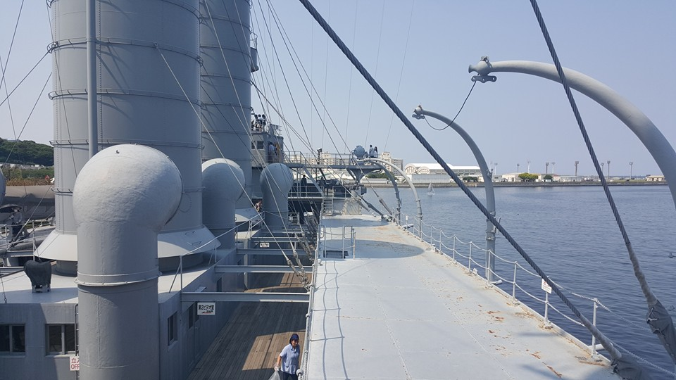 A VIEW FROM THE BATTLESHIP'S SUPERSTRUCTURE, LOOKING OUT OVER YOKOSUKA HARBOR. MUCH OF THE MIKASA'S UPPER WORKS ARE NOT ORIGINAL, HAVING BEEN STRIPPED FOLLOWING WORLD WAR II AND REPLACED BY REPRODUCTIONS DURING THE POST-WAR RESTORATION. PHOTO: AUTHOR.