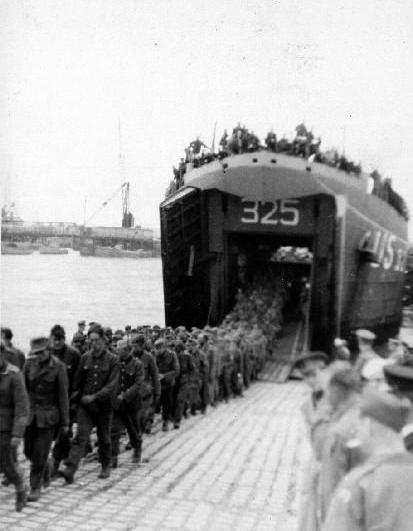 German prisoners debarking USS LST-325 in England following the invasion of Normandy. Photo source: Navsource.org.