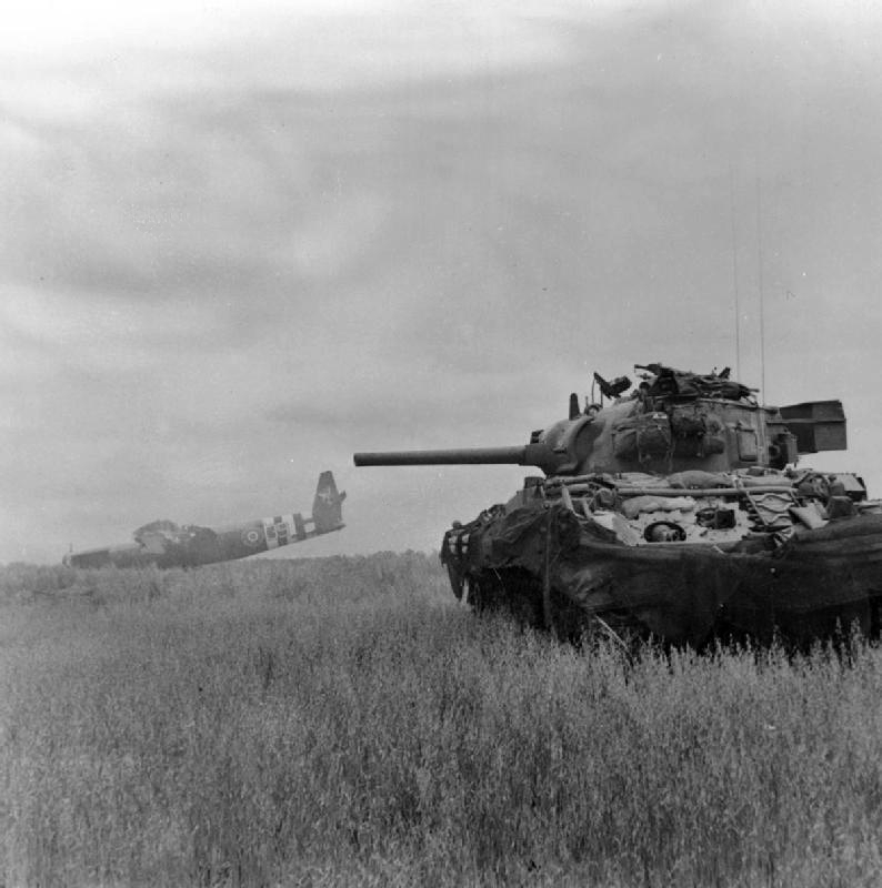 A British Sherman in action in Normandy shortly after D-Day. Photo source: Wikipedia.