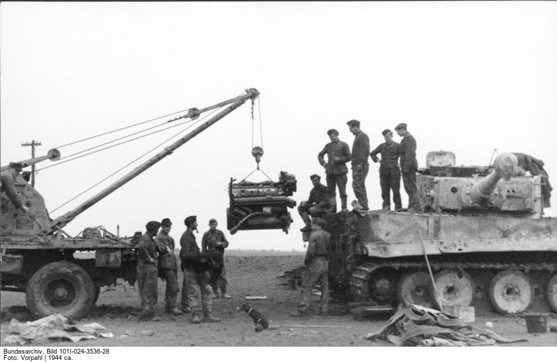 A Tiger I having its engine serviced along the Eastern Front. Photo source: Bundesarchiv.