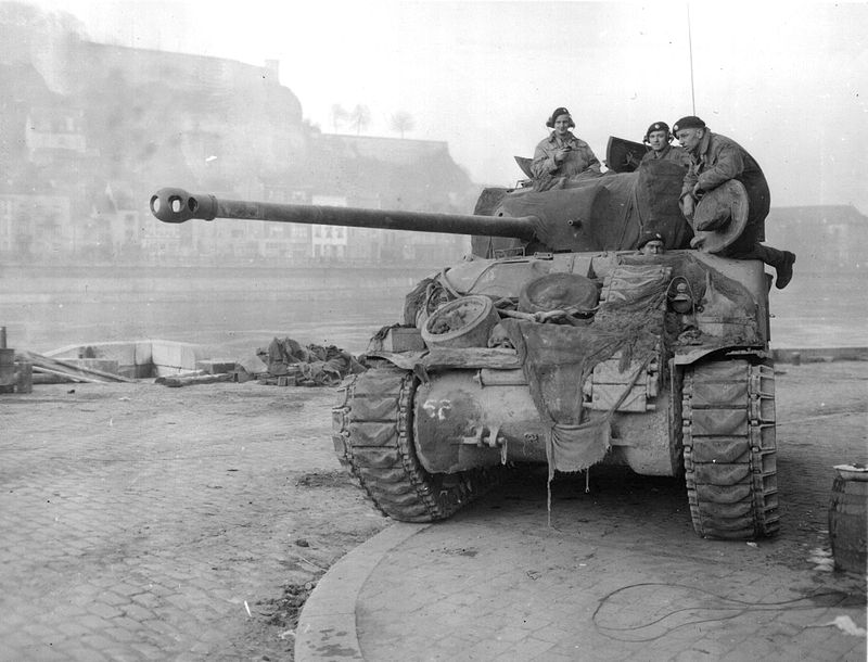 A British Firefly in Namur, 1944. With its 17-pounder anti-tank gun, the Firefly was the only tank that the Western allies had capable of penetrating the Tiger's frontal armor. German tankers quickly realized the danger posed by these tanks and would target them first, leading Firefly tankers to camoflauge the barrels of their Fireflies in turn to disguise them as regular Shermans. Photo source: Wikipedia.