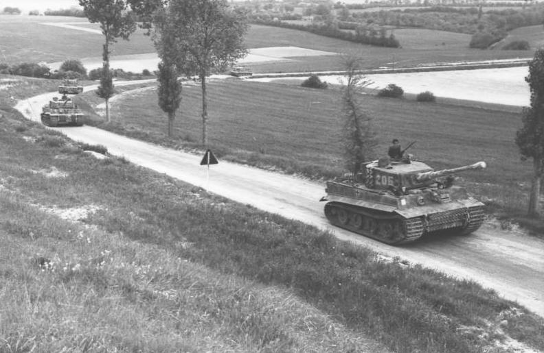 A column of Tiger Is on the move in Northern France in the summer of 1944. Photo source: Wikipedia.