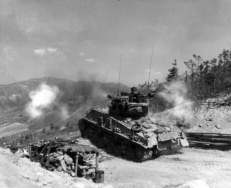 "A M4A3E8 ""Easy Eight"" Sherman firing on communist positions during the Korean War. Photo source: Wikipedia."