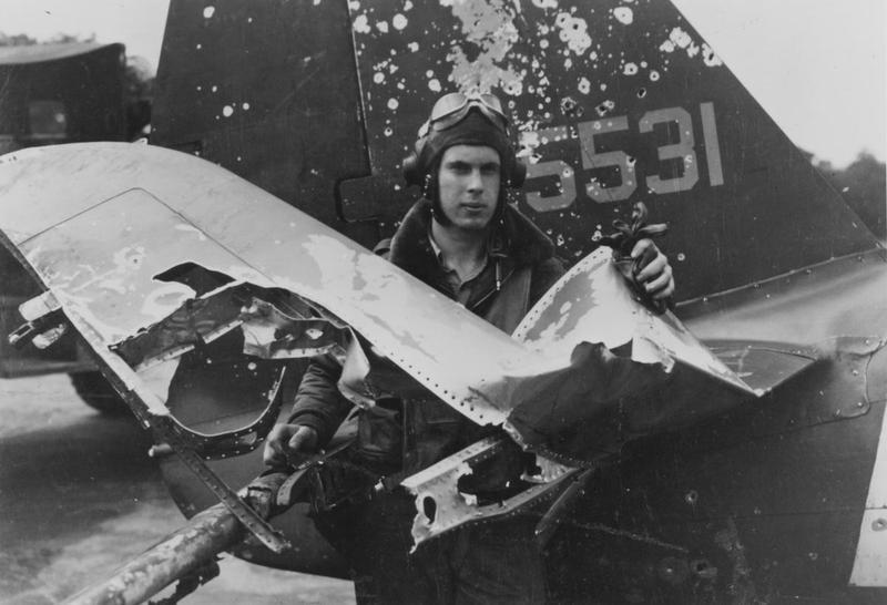 Another pilot stands among the remains of his right horizontal stabilizer, which was clearly hit by flak, spraying shrapnel into the tail and fuselage. This kind of damage was not at all uncommon during the dangerous close air support and ground attack missions undertaken by Thunderbolt pilots on a routine basis. Photo source: Cradle of Aviation Museum.