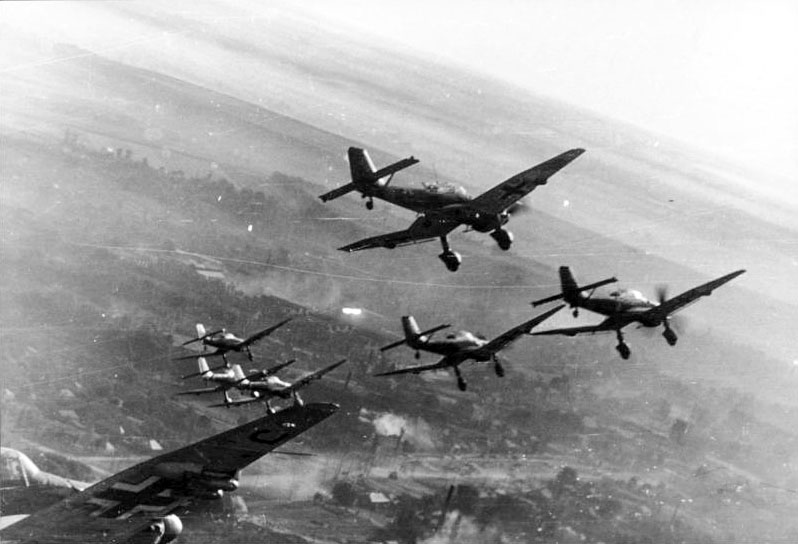 The Red Air Force's fragility in the early months of the war gave new life to the Stuka's combat career. Here a flight of Ju-87Ds fly in tight formation low over a Russian town. Photo source: Wikipedia.