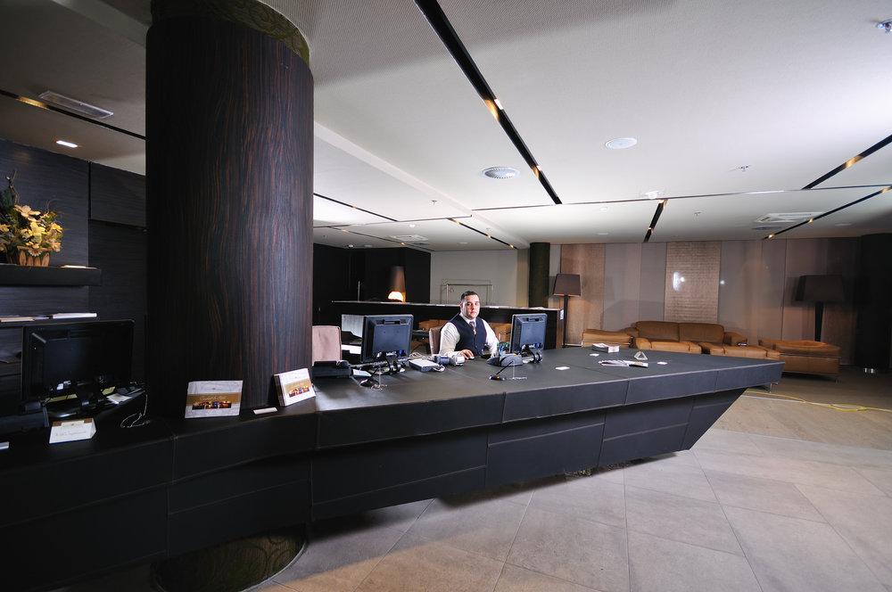 bigstock-reception-service-man-hotel-in-14818628.jpg