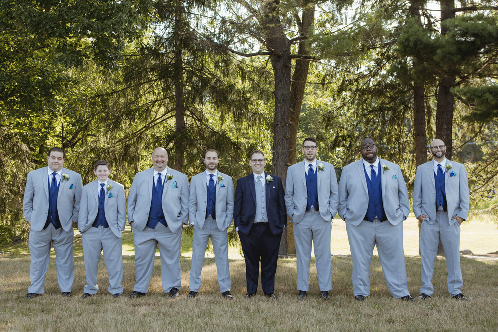 Groom poses in Navy suit, groomsmen wear grey suits with navy vests - New Rochelle wedding - New York wedding - Hudson Valley wedding - Heather & Ian's wedding - Amy Sims Photography