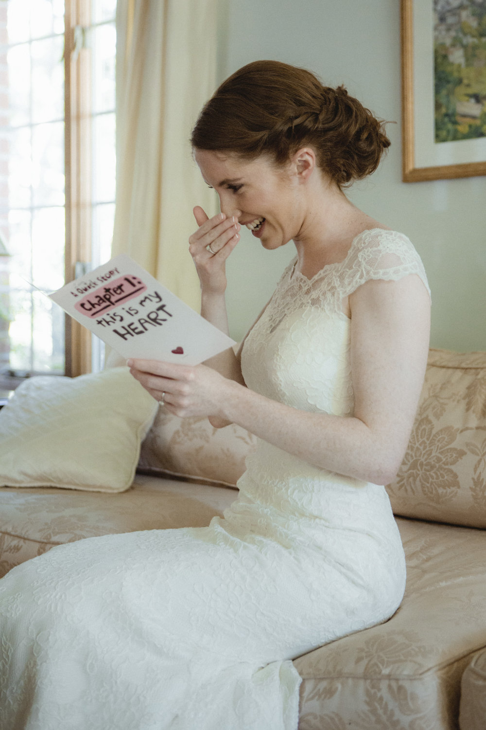 Bride laughs while reading card from her husband-to-be - Estate at Florentine Gardens wedding - Hudson Valley Wedding - Kelsey & Anish's wedding - Amy Sims Photography