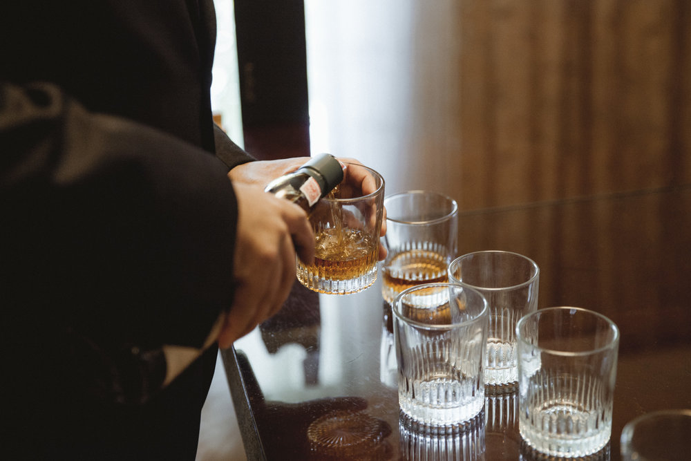 Groomsman pours the whiskey for a toast - Estate at Florentine Gardens wedding - Hudson Valley Wedding - Kelsey & Anish's wedding - Amy Sims Photography