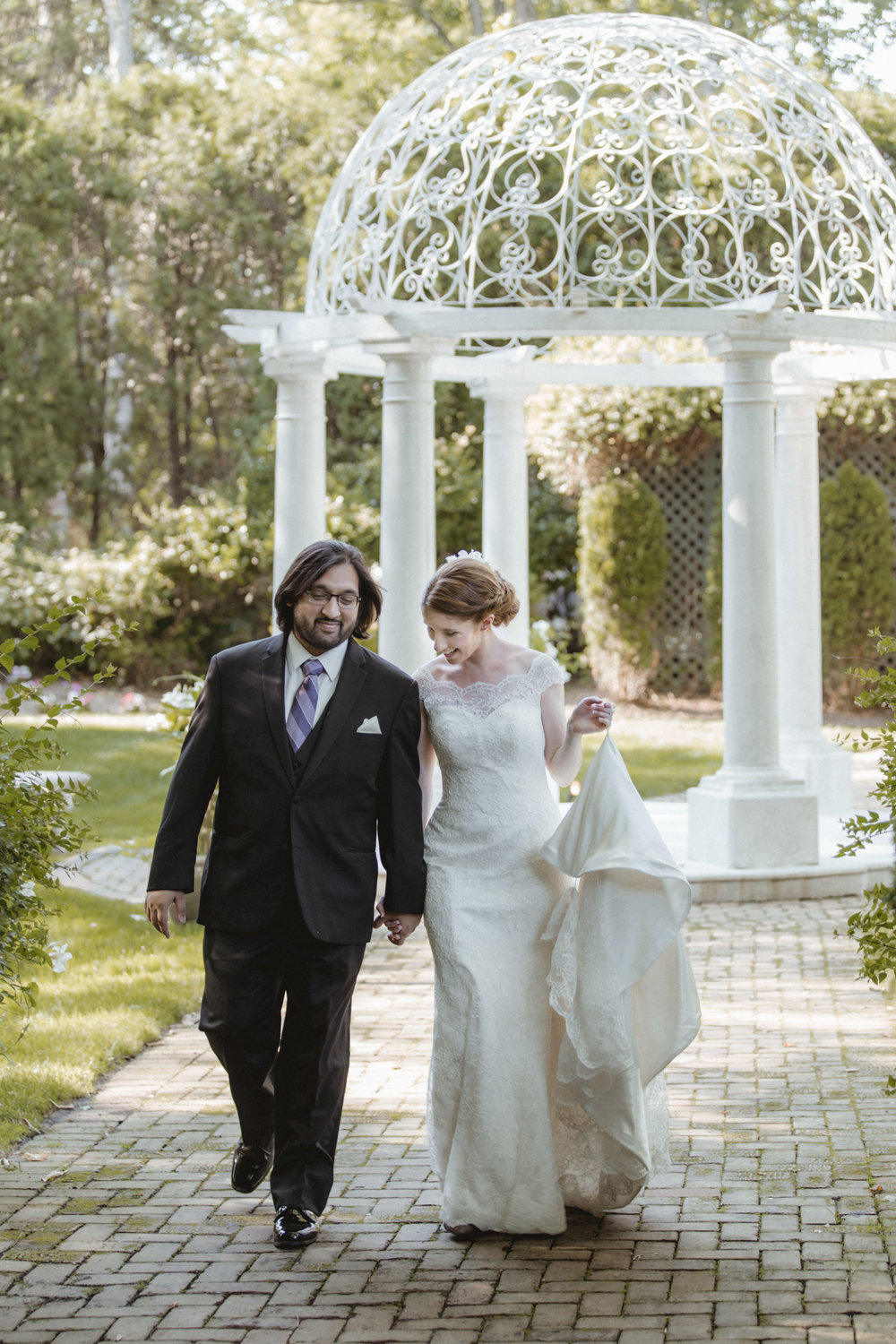 Bride and groom walk through garden - Estate at Florentine Gardens wedding - Hudson Valley Wedding - Kelsey & Anish's wedding - Amy Sims Photography