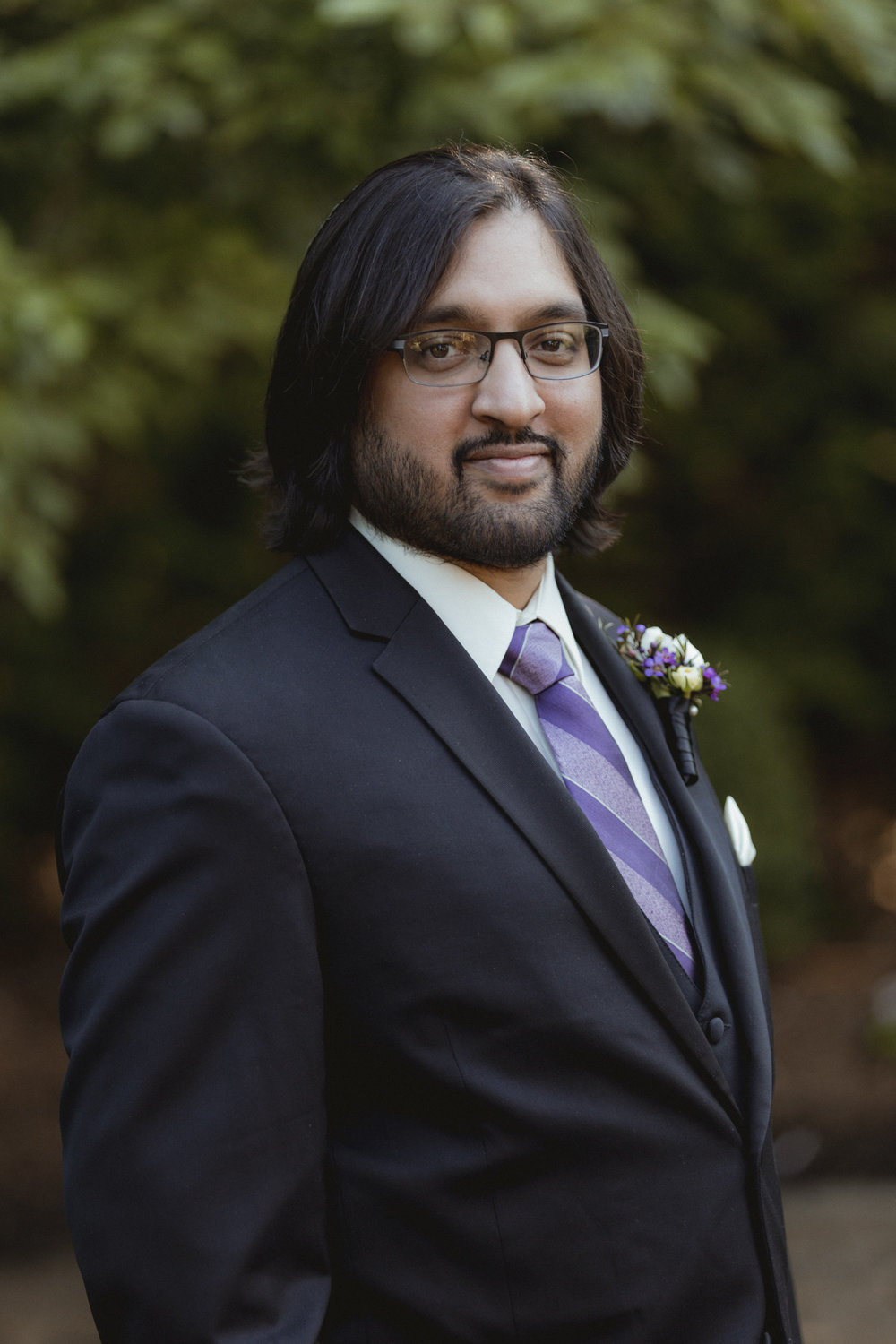 Groom poses in black suit with purple striped tie - Estate at Florentine Gardens wedding - Hudson Valley Wedding - Kelsey & Anish's wedding - Amy Sims Photography