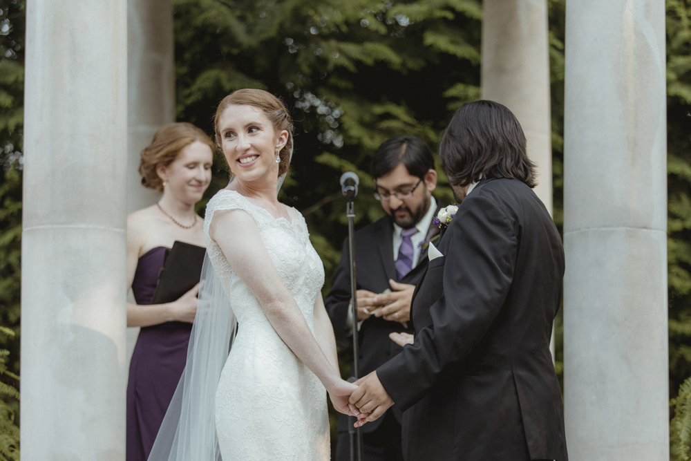 Bride turns to smile at her parents during ceremony - Estate at Florentine Gardens wedding - Hudson Valley Wedding - Kelsey & Anish's wedding - Amy Sims Photography