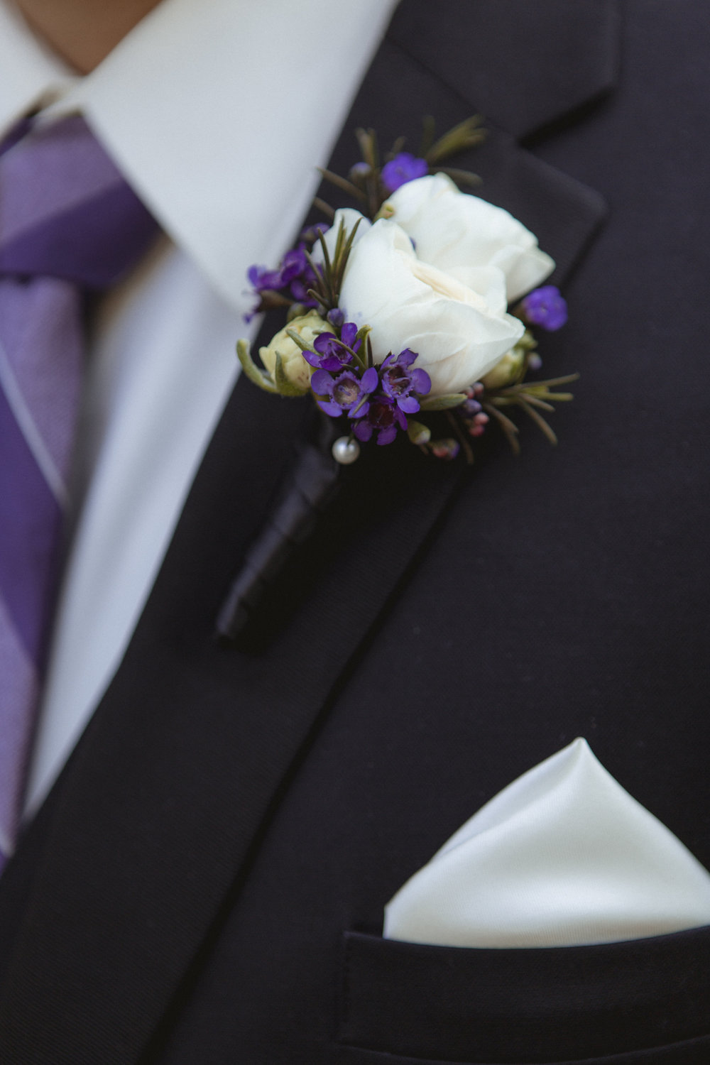 Close up of Groom's boutineer by Floral Expression by Maria & Larry boutineer