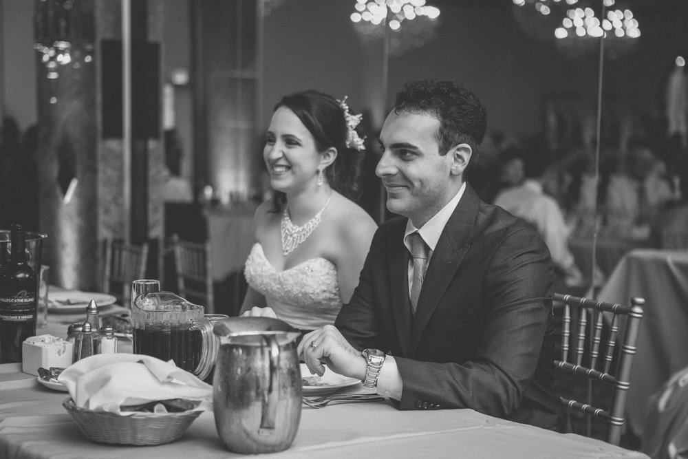 Couple smiles during toasts | Scavello's on the Island | Manhattan wedding | Bronx Wedding | Cathy & Antonello's wedding | Amy Sims Photography