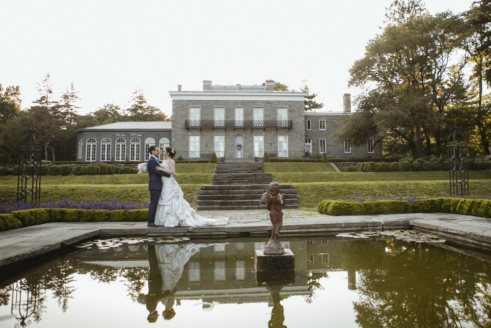 Couple pose together by garden pond | Bartow-Pell Mansion wedding | Manhattan wedding | Bronx Wedding | Cathy & Antonello's wedding | Amy Sims Photography