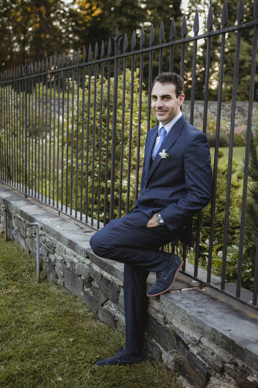 Groom poses in his navy Sean John suit | Bartow-Pell Mansion wedding | Manhattan wedding | Bronx Wedding | Cathy & Antonello's wedding | Amy Sims Photography
